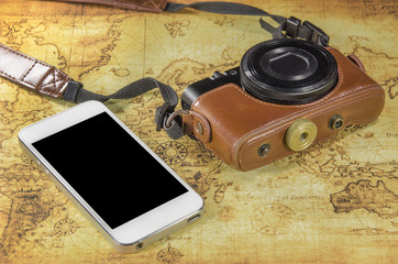smartphone and pocket camera on a world map
