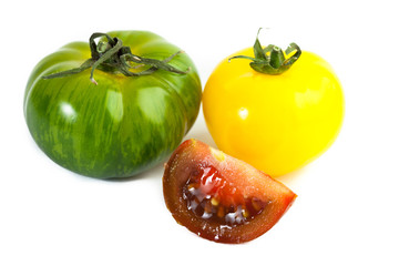 Different colors tomatos, Solanum lycopersicum, on white backgroung