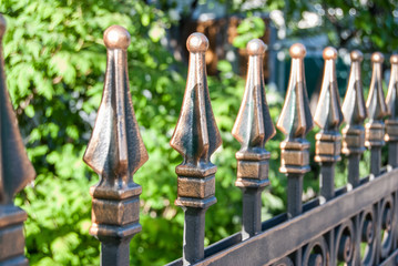 Forge Detail. Part of iron gate details. Fragment forged fence on outdoor