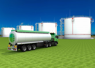 Fuel truck and vertical steel tanks on field