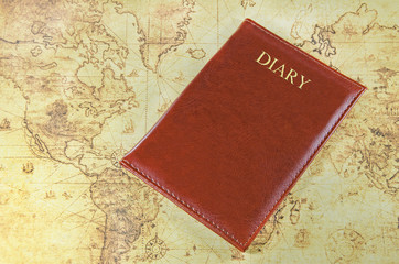 mini notebook on a old world map