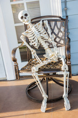 skeleton sit at the armchair and wait