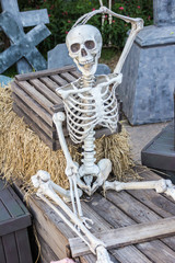 skeleton sit at the box and wait