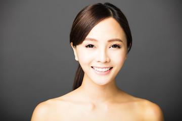closeup beautiful young smiling  woman  face