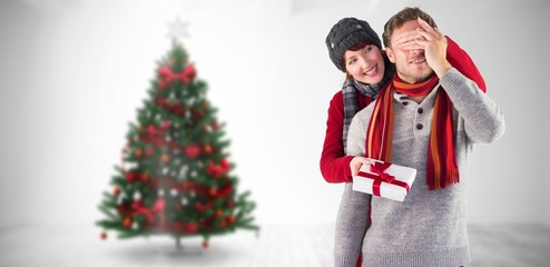 Composite image of woman giving man a present