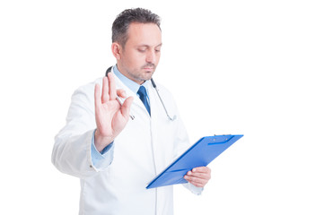 Doctor or medic making hold and wait gesture