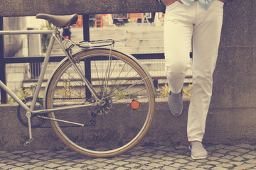 Hipster guy with old bicycle.