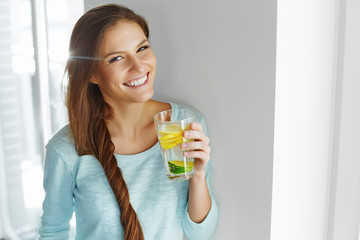 Healthy Lifestyle And Food. Woman Drinking Fruit Water. Detox.