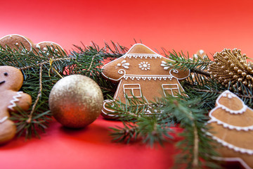Christmas cookies with festive decoration on the red background.