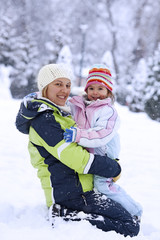 Mother and daughter on snow