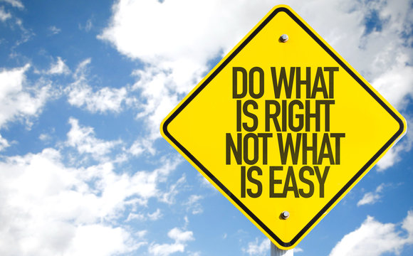 Do What Is What Not What Is Easy sign with sky background