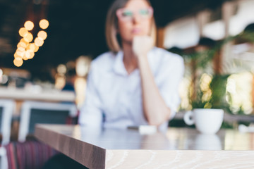 Woman in cafe, blurred background