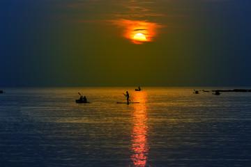 Tourists kayaking on tropical island