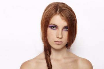 Closeup portrait of adorable cute redhead woman with violet smokey eyes makeup isolated