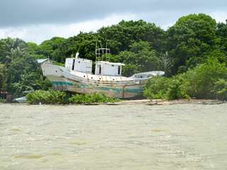Ship wreck at the estuary of the Grand River South East in the eastern Part of Mauritius.