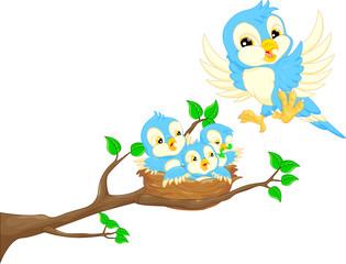 Flying bird and little bird in the nest