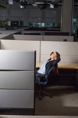 Office woman leaning back in her cubicle