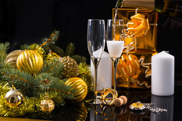 Champagne Glasses with Candles and Christmas Gifts