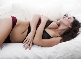 Sensual girl portrait sleeping on bed