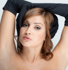 Beautiful Young Woman in Long Black Gloves