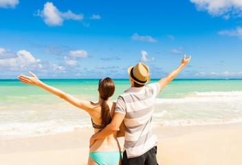 Couple enjoying sunny day at the beach