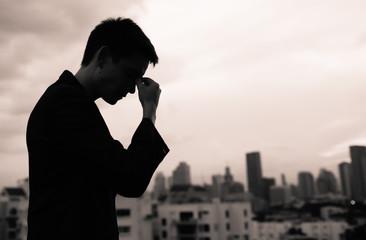 Sad man walking in the city