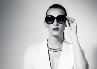 Female fashion portrait wearing sunglasses.