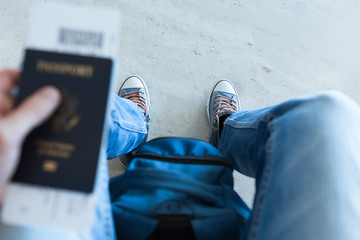 Male traveler holding passport