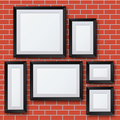 Vector blank picture frame set on brick wall.