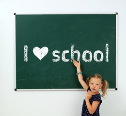 Cheerful girl at the blackboard. I love learning concept