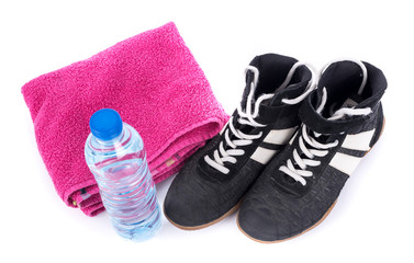 Sport shoes with terry towel and bottle of water
