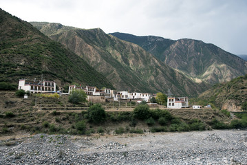 village near mountain on the road form Kunming to Shangri-la, Ch
