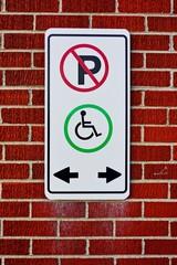 only handicapped parking sign on the brick wall