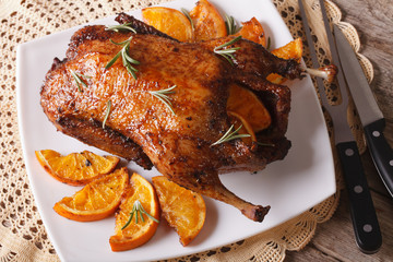 whole baked duck with oranges and rosemary close up. horizontal