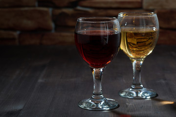 two glasses of wine on the background of a brick wall