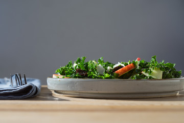 Kale salad with apples, almond slices and raisins. Selective focus