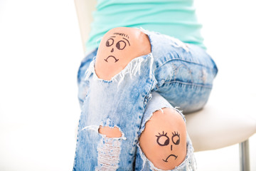 divorce in the family. Sad smiley on jeans.  men and women turned away, the couple quarrel, drawn in a lap detuned person, face turned away
