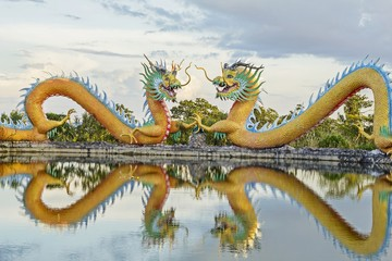 Colorful twins dragon statue with beautifully blue sky at public park