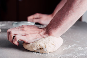 Man making dough for pizza