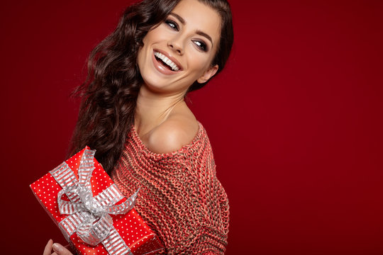 Beautiful woman portrait hold gift in christmas color style . Sm