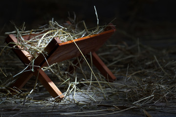 Manger in the stable abstract christmas symbol