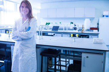 Scientist smiling at the camera in lab