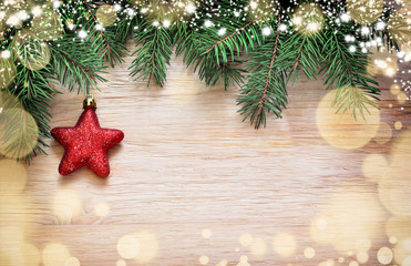 Christmas wooden background. Pine and star.
