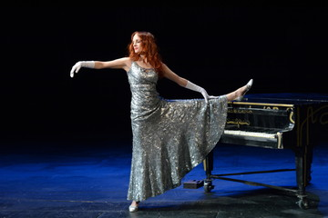 actress with a Grand piano on the stage