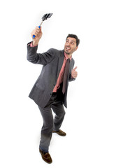 young attractive businessman taking selfie photo with mobile phone camera and stick posing happy