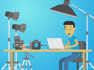 Photographer working on desktop surrounded by photography equipment in studio flat style