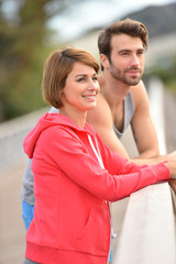 Portrait of athletic people relaxing after jogging