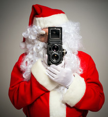 Santa using a vintage camera