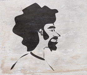 man with afro on wood texture