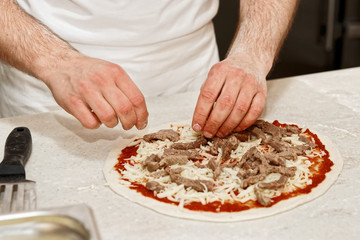Making of a meat pizza